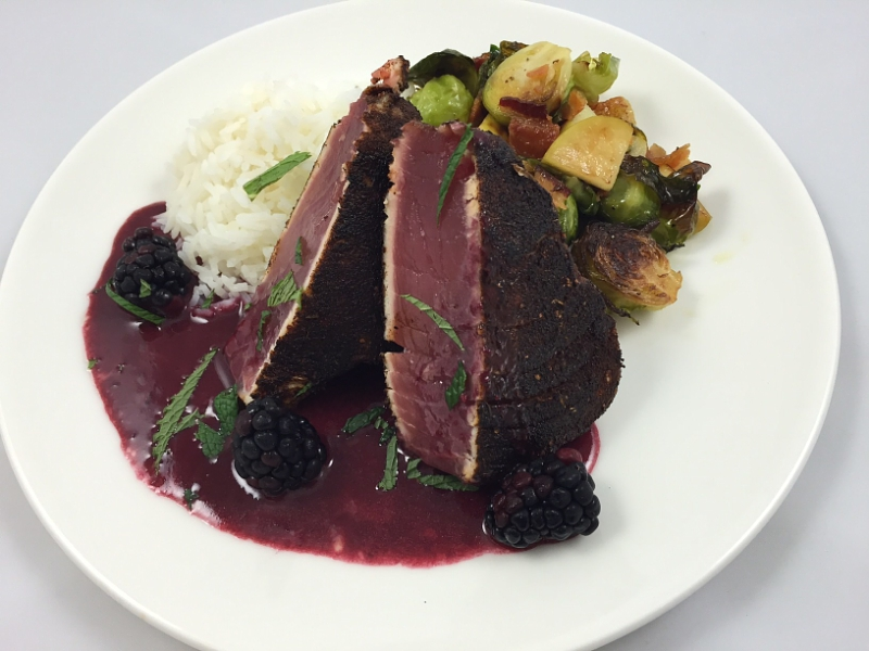 "Legal Sea Foods is serving up two d-electable presidential dishes leading up to Election Day.  Guests at all restaurants can choose between the ""Secretary of Steak"" (pictured here) or the ""Trump Tower.""  The Clinton-inspired dish is a liberal helping of blackened tuna steak with jasmine rice, bacon-braised Brussels sprouts and blackberry beurre rouge. (PRNewsFoto/Legal Sea Foods)"