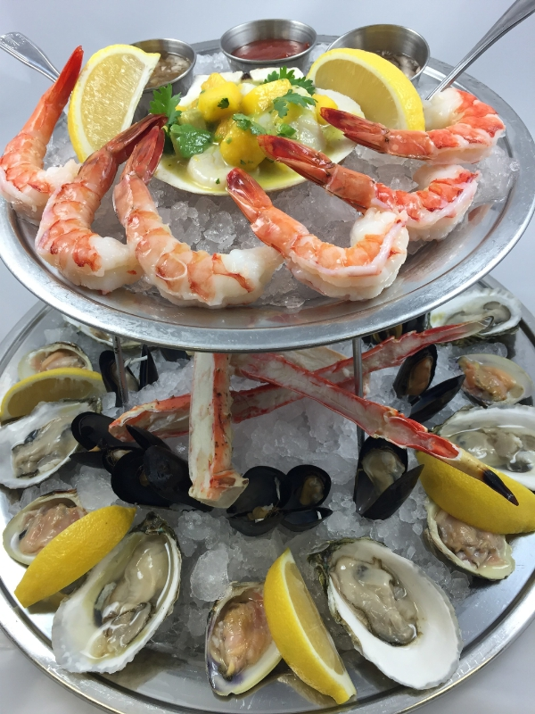 "Legal Sea Foods is serving up two d-electable presidential dishes leading up to Election Day.  Guests at all restaurants can choose between the ""Secretary of Steak"" or the ""Trump Tower  (pictured here).  The over-the-top, two-tiered Trump offering feeds any grand old party.  Scallop mango ceviche, king crab, marinated mussels, shrimp cocktail, oysters and littlenecks on the half shell make dinner great again (PRNewsFoto/Legal Sea Foods)"
