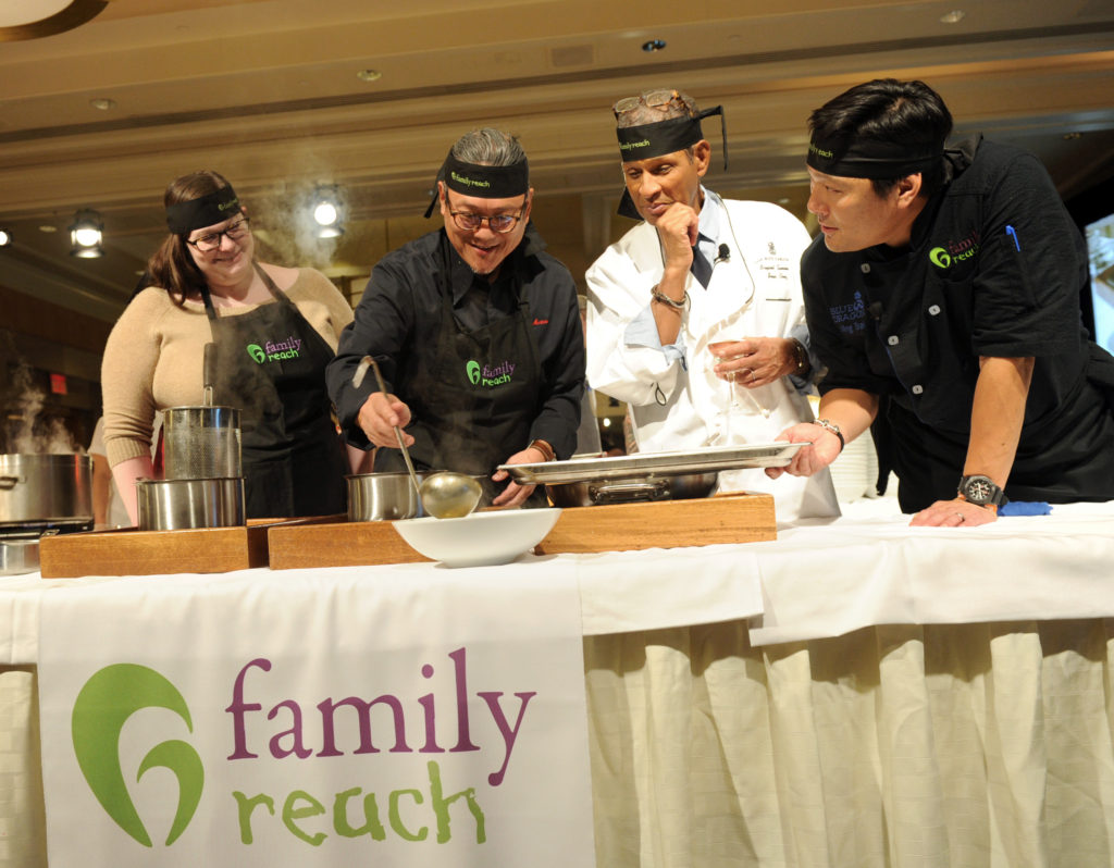 Iron Chef Morimoto, center left, and veteran broadcaster Bryant Gumbel, center right, with chef Ming Tsai, right, and guest Christine Rogers, left, prepare a dish at Family Reach's Cooking Live! charity event, Monday, Nov. 14, 2016 at The Ritz-Carlton New York, Battery Park.  The event raises funds to help families facing the daily cost of cancer.  (Photo by Diane Bondareff/Invision for Family Reach/AP Images)